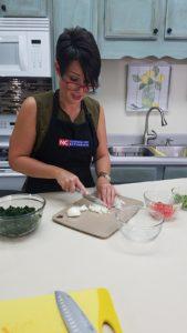 Rebecca slicing vegetables