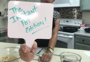 "Extension Director holding sign that says ""The Instant Pot Edition"""