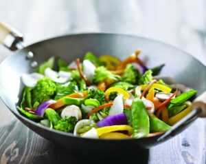 Fresh stir-fry vegetables in a wok