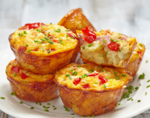 Egg Muffins on a plate sprinkled with fresh chives